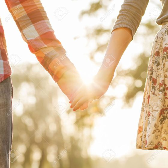 24258173-young-couple-in-love-walking-in-the-autumn-park-holding-hands-looking-in-the-sunset